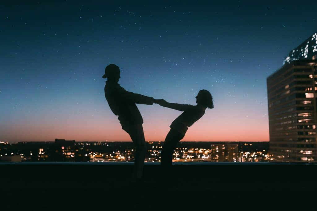 Make Dates Fun - Couple on a Rooftop