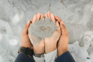 Rings and Hands in the Sand for a Happy Marriage