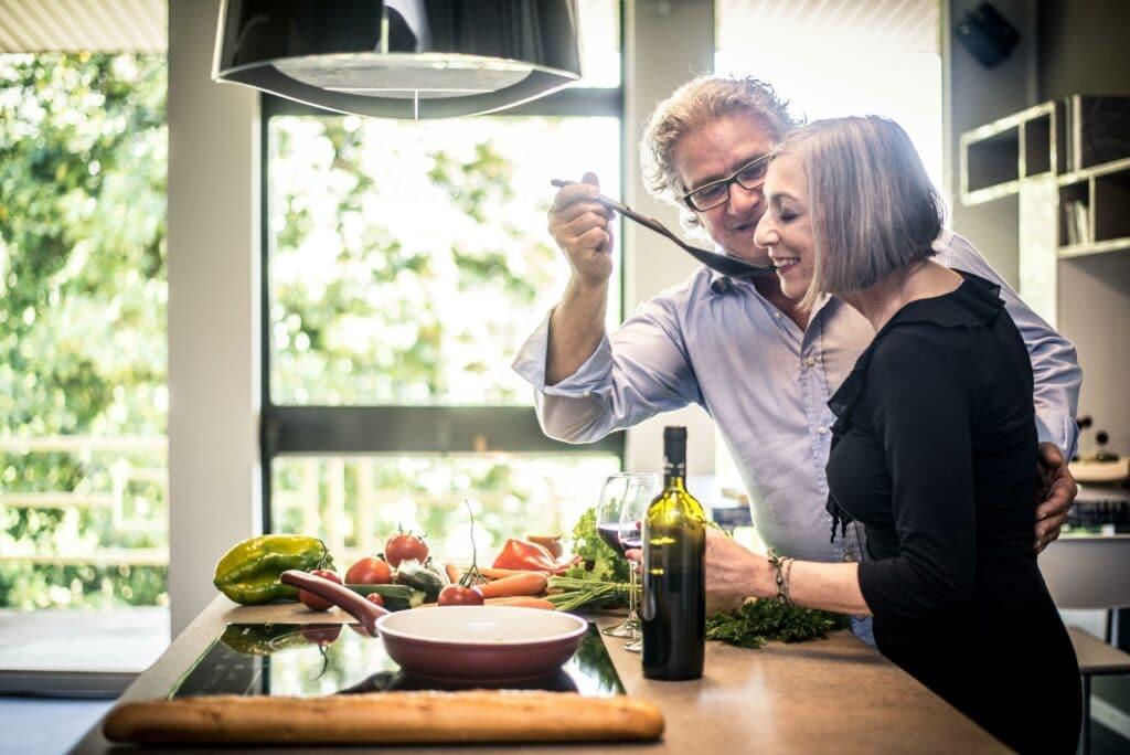Senior Couple Tasting a Homemade Meal