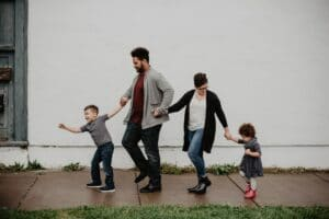 Blended Family of Four with Two Kids Walking Down the Street